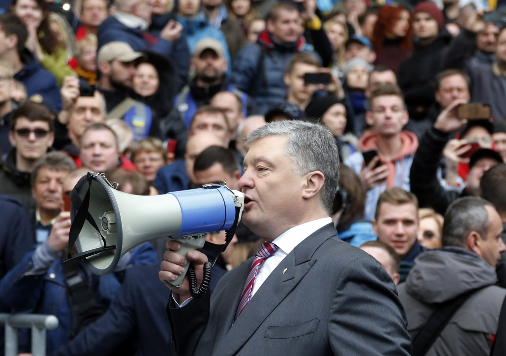 FILE - In this Sunday, April 14, 2019 file photo, Ukrainian President Petro Poroshenko talks to his supporters ahead of the presidential elections, at...