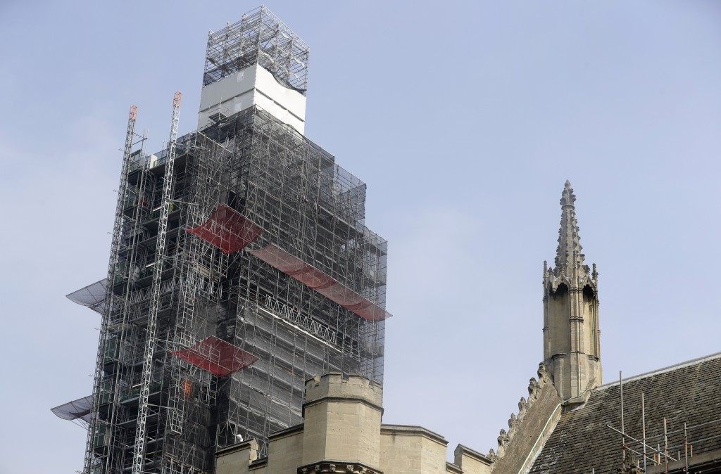 In this photo taken on Wednesday, April 17, 2019, Britain's Elizabeth Tower which houses the clock Big Ben is covered in scaffolding, in London. For s