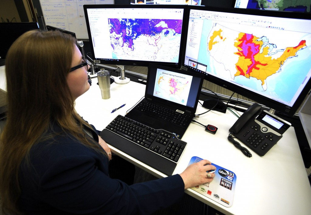 FILE - In this March 21, 2019 file photo, Whitney Flynn, a physical scientist at the National Water Center in Tuscaloosa, Ala., works on computer scre...