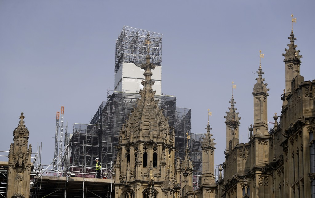 In this photo taken on Wednesday, April 17, 2019, Britain's Houses of Parliament, covered in hoarding and scaffolding as it undergoes restoration work