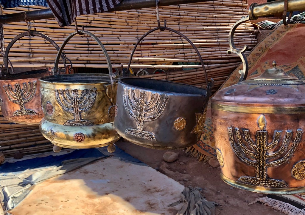 This Jan. 16, 2019, photo shows cooking pots adorned with menorahs in an outdoor stall near Ksar of Ait-Ben-Haddou in southern Morocco. The North Afri