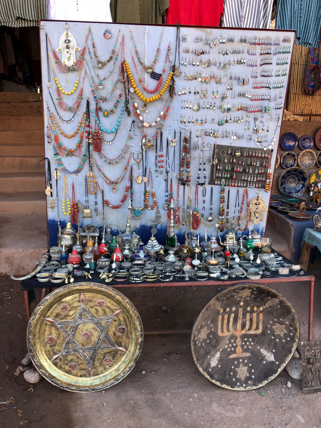 This Jan. 16, 2019, photo shows platters adorned with a menorah and Jewish stars in an outdoor stall near Ksar of Ait-Ben-Haddou in southern Morocco.