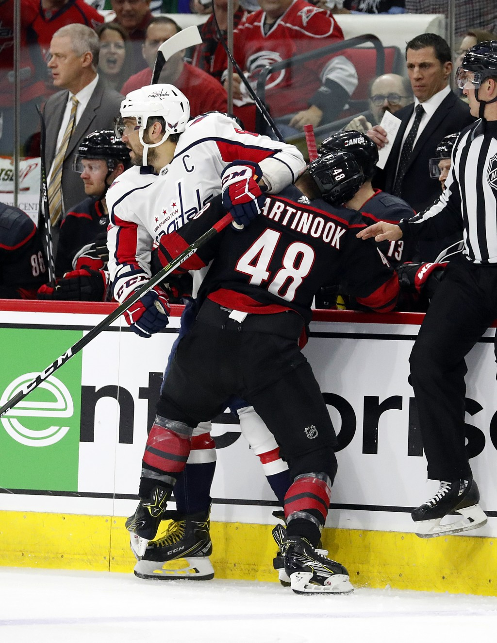 Carolina Hurricanes' Jordan Martinook (48) collides with Washington Capitals' Alex Ovechkin (8), of Russia, during the first period of Game 4 of an NH...