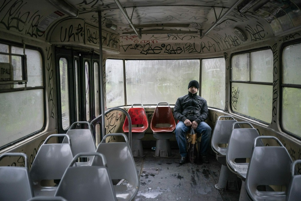 In this photo taken on Monday, April 15, 2019, a man sits in an empty tram in Kryvyi Rih, eastern Ukraine. Residents of the industrial city complain a