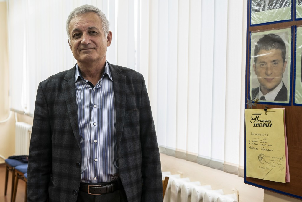 In this photo taken on Monday, April 15, 2019, physics teacher Volodymyr Tignian speaks to The Associated Press in Kryvyi Rih, in eastern Ukraine, abo