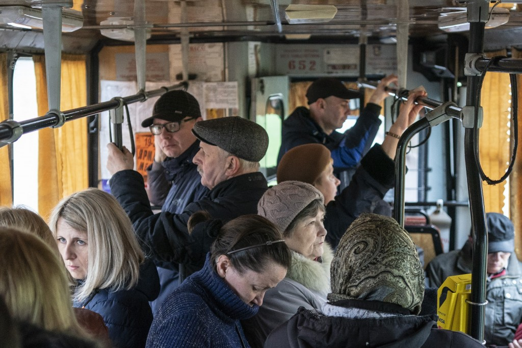 In this photo taken on Monday, April 15, 2019, people ride a trolley bus in Kryvyi Rih, in eastern Ukraine. Residents of the industrial city complain