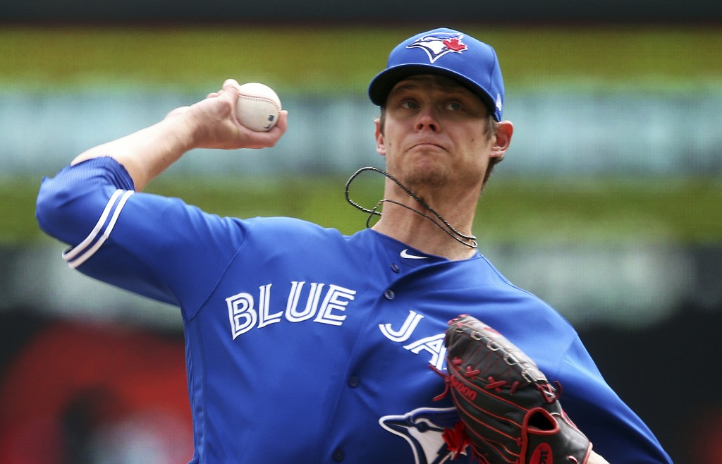Toronto Blue Jays pitcher Clay Buchholz throws against the Minnesota Twins in the first inning of a baseball game Thursday, April 18, 2019, in Minneap...
