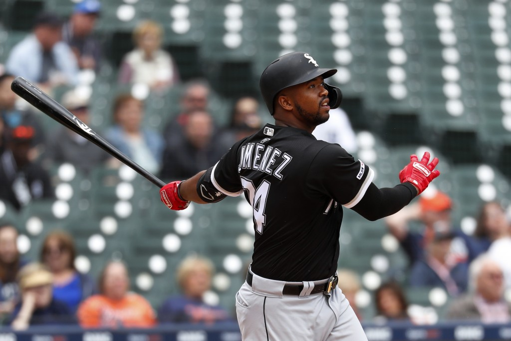 Chicago White Sox's Eloy Jimenez hits a two-run home run against the Detroit Tigers in the sixth inning of a baseball game in Detroit, Thursday, April
