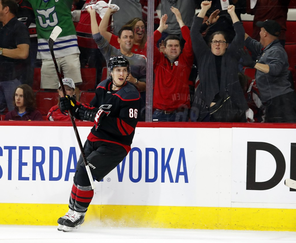 Carolina Hurricanes' Teuvo Teravainen, of Finland, reacts after scoring a goal against the Washington Capitals during the second period of Game 4 of a...