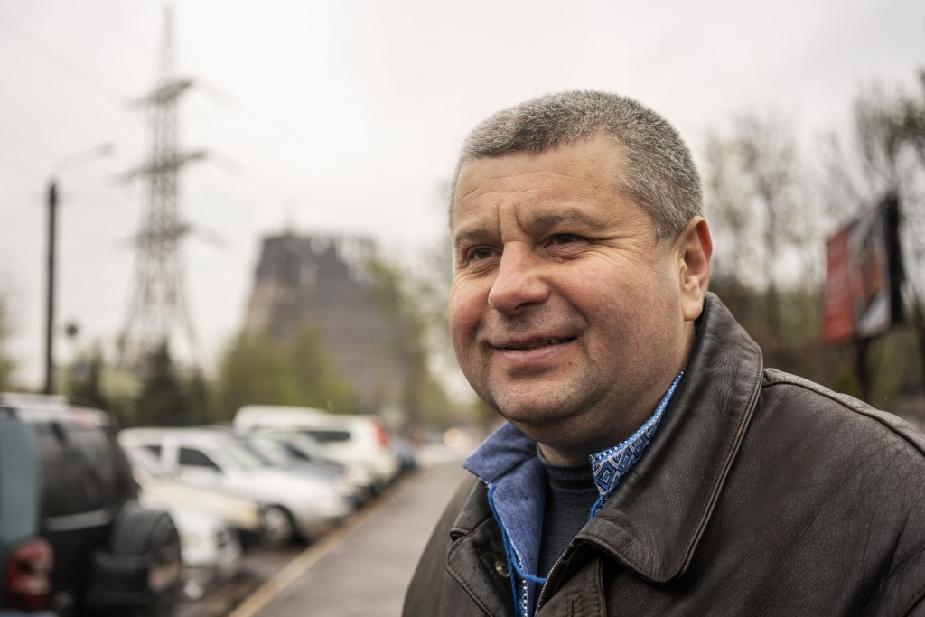 In this photo taken on Monday, April 15, 2019, Ihor Lyakh, 45, who works as an engineer at Ukraine's biggest steel plant, speaks to The Associated Pre...