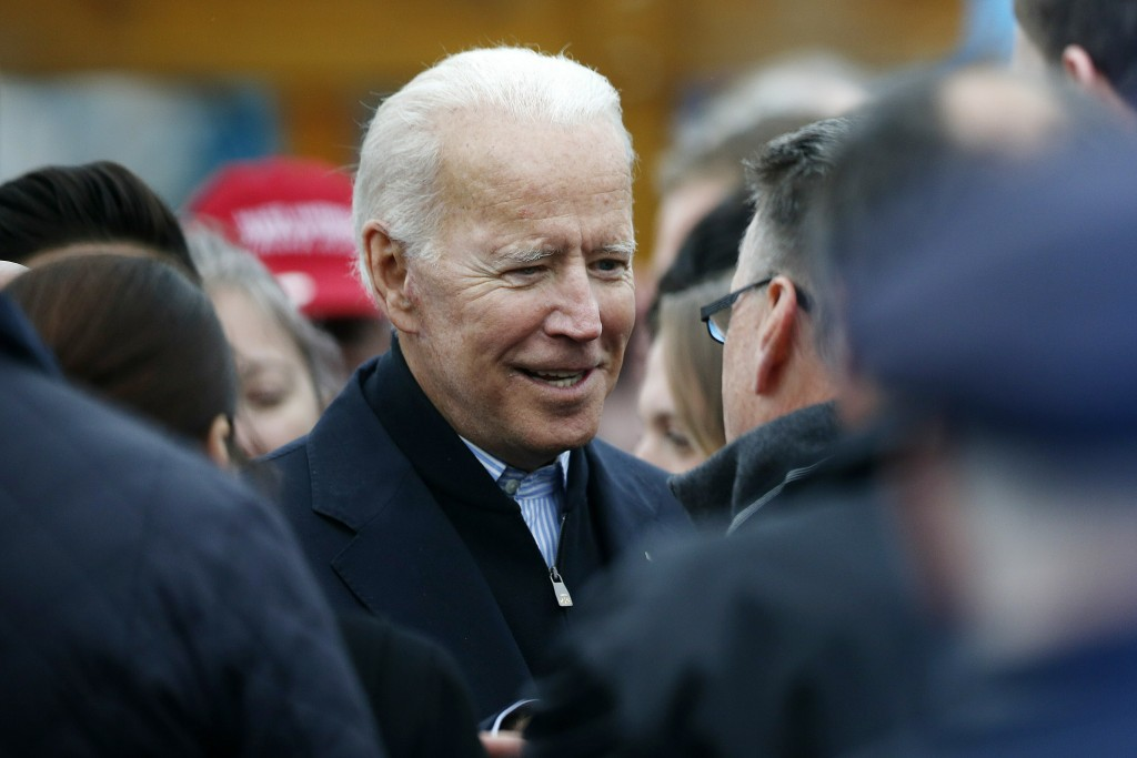 Former vice president Joe Biden talks with officials after speaking at a rally in support of striking Stop & Shop workers in Boston, Thursday, April 1