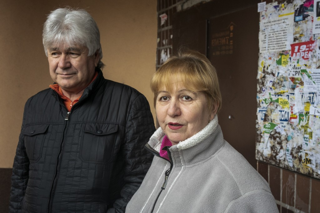 In this photo taken on Monday, April 15, 2019, Olha Zyusko, 60, and Alexander Zyusko, 64, left, supporters of presidential candidate Volodymyr Zelensk...