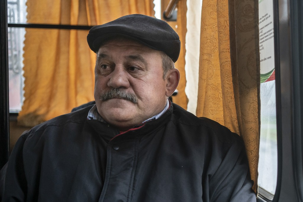 In this photo taken on Monday, April 15, 2019, Mykola Andreichik sits in a trolley bus in Kryvyi Rih, in eastern Ukraine, and talks about the poor eco