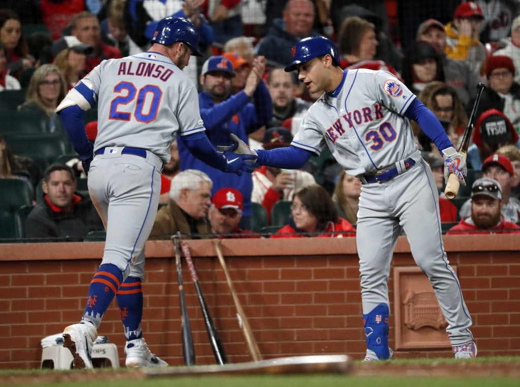 New York Mets' Pete Alonso (20) is congratulated by Michael Conforto (30) after hitting a solo home run during the sixth inning of a baseball game aga