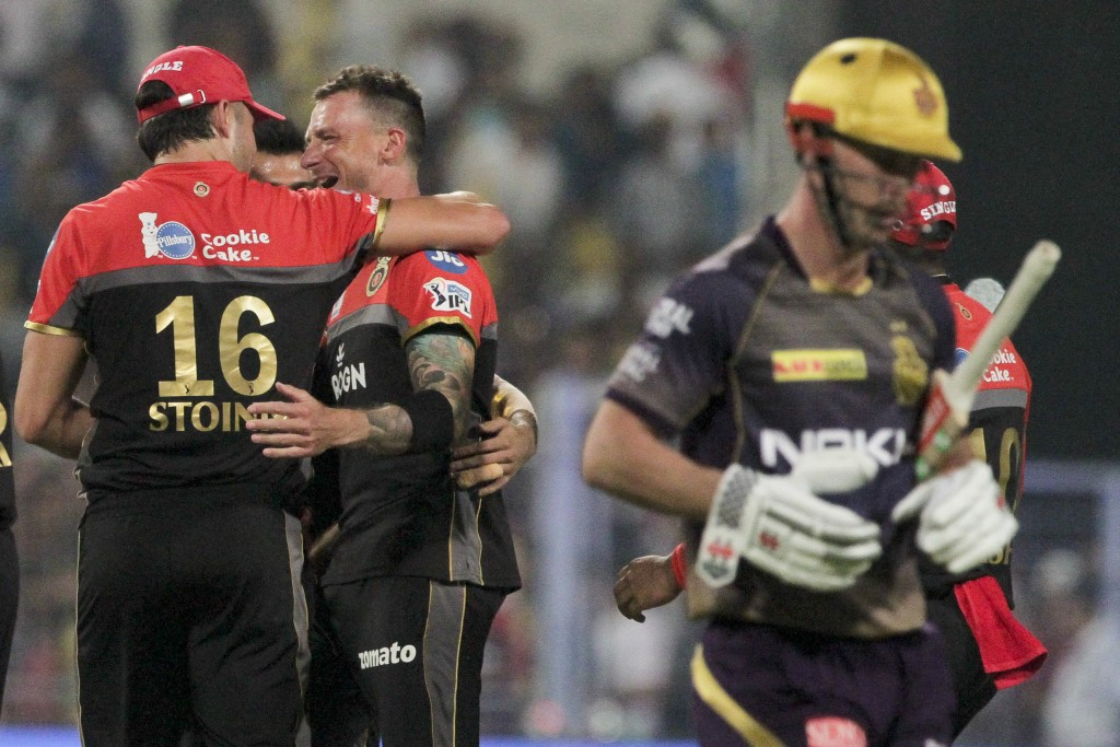 Royal Challengers Bangalore's bowler Dale Steyn, without cap, and teammates celebrate the dismissal of Kolkata Knight Riders' Chris Lynn, right, durin...