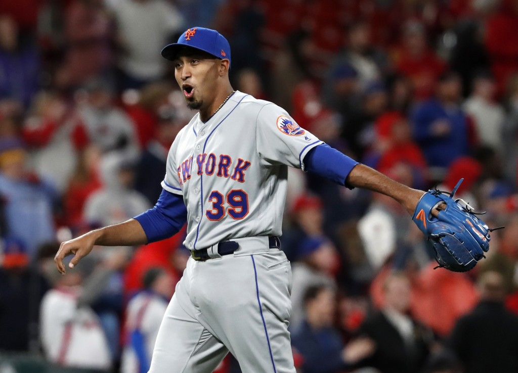 New York Mets relief pitcher Edwin Diaz celebrates after getting St. Louis Cardinals' Yadier Molina to fly out for the final out of a baseball game Fr
