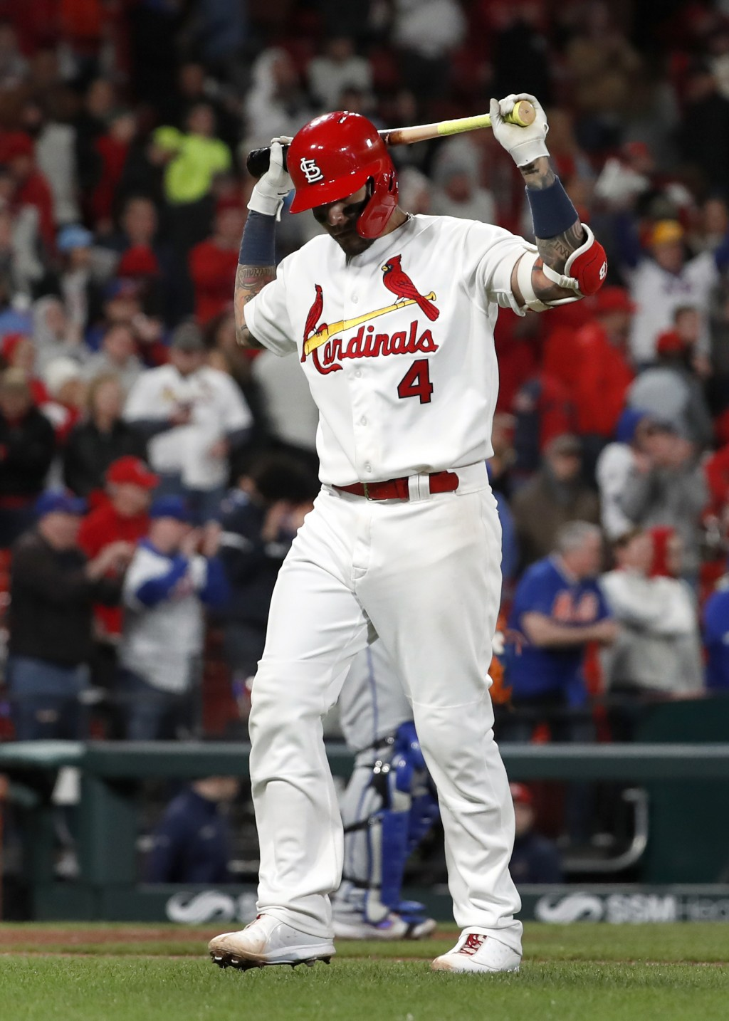 St. Louis Cardinals' Yadier Molina reacts after flying out to end a baseball game against the New York Mets on Friday, April 19, 2019, in St. Louis. T