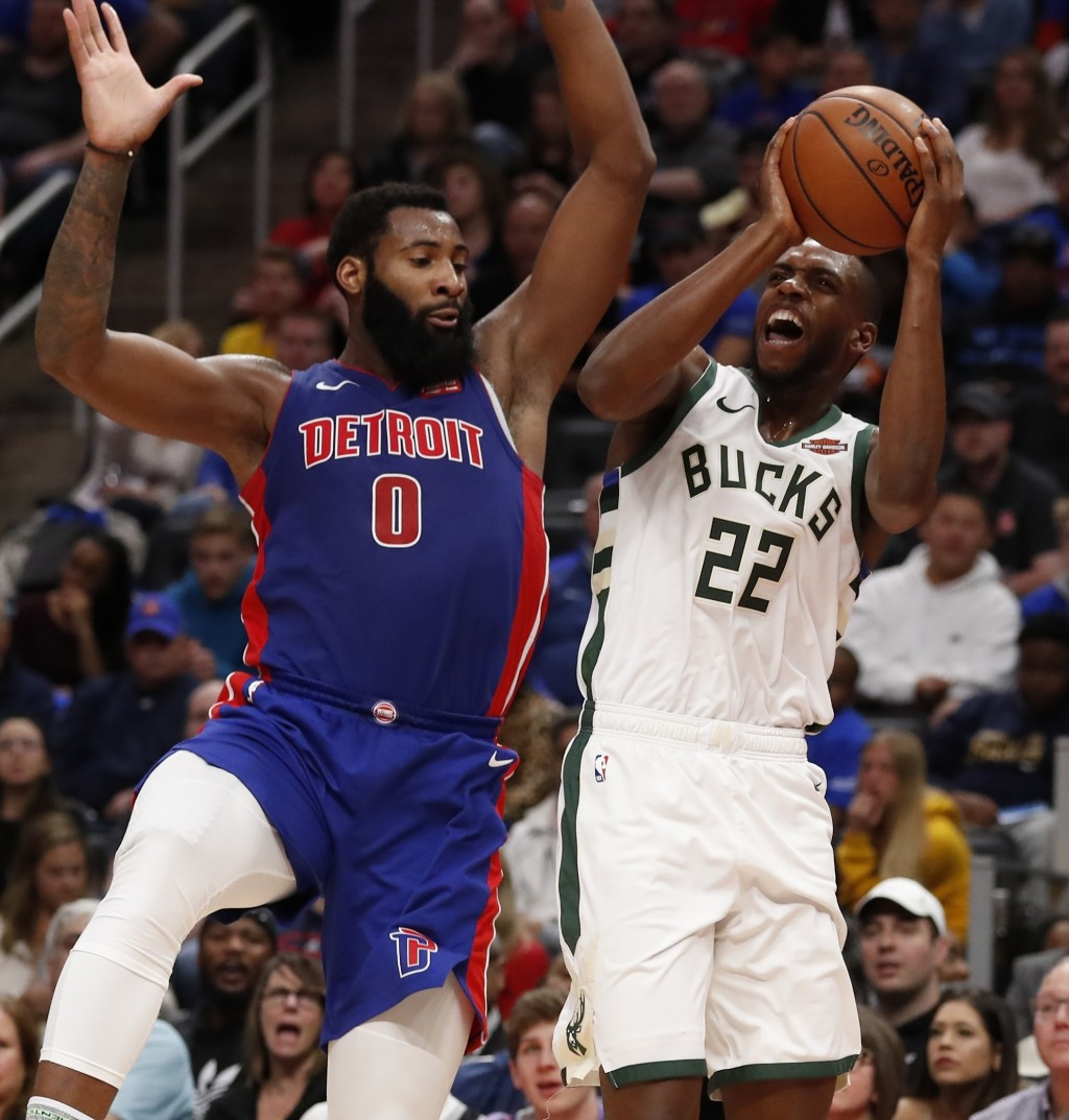 Milwaukee Bucks forward Khris Middleton (22) shoots as Detroit Pistons center Andre Drummond (0) defends during the first half of Game 3 of a first-ro...