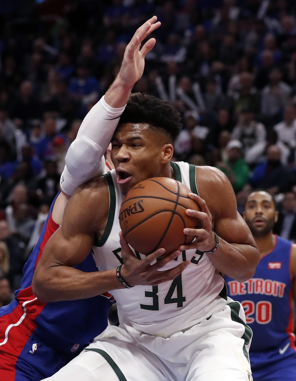 Milwaukee Bucks forward Giannis Antetokounmpo (34) is defended by Detroit Pistons forward Blake Griffin during the first half of Game 3 of a first-rou...