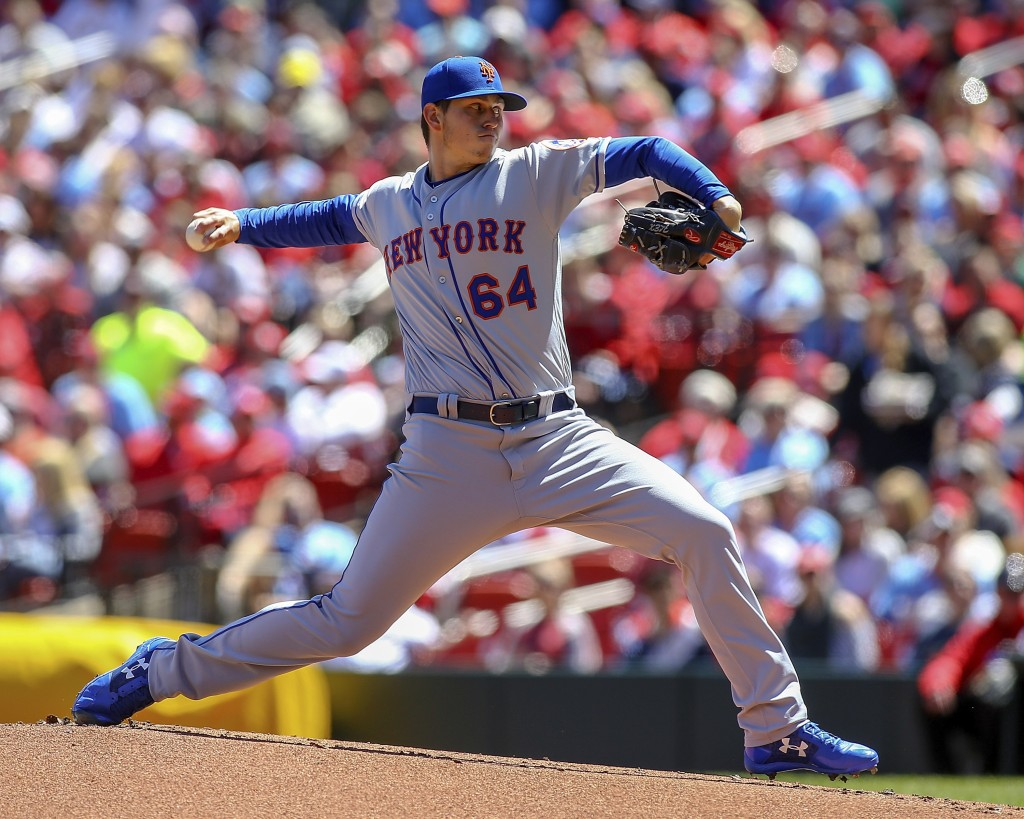 New York Mets starting pitcher Chris Flexen (64) throws during the first inning of a baseball game against the St. Louis Cardinals Saturday, April 20,...