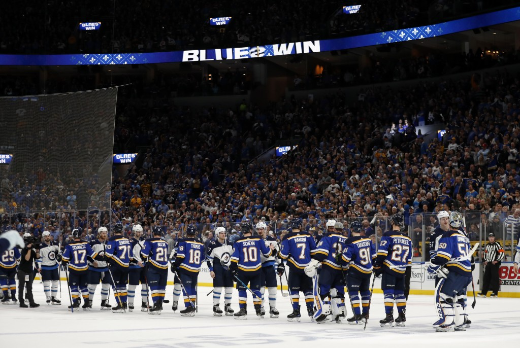 Members of the St. Louis Blues and the Winnipeg Jets shake hands following Game 6 of an NHL first-round hockey playoff series, Saturday, April 20, 201...