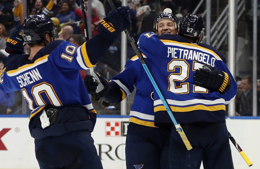 St. Louis Blues' Jay Bouwmeester celebrates with teammates Brayden Schenn (10) and Alex Pietrangelo after defeating Winnipeg Jets in Game 6 of an NHL