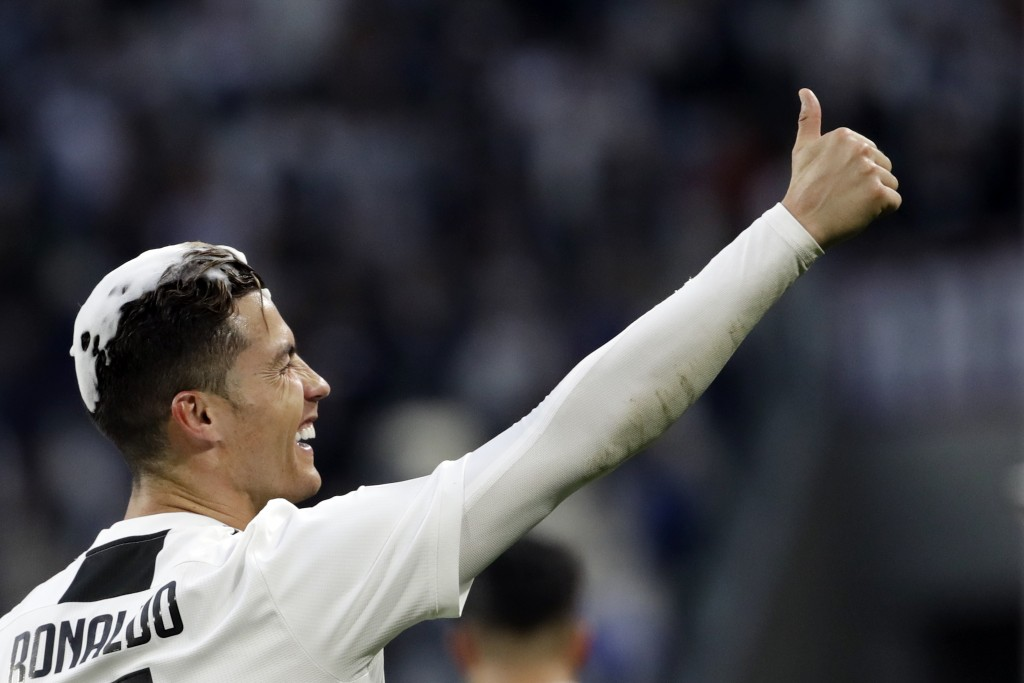 Juventus' Cristiano Ronaldo celebrates at the end of a Serie A soccer match between Juventus and AC Fiorentina, at the Allianz stadium in Turin, Italy...