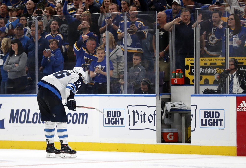 Winnipeg Jets' Blake Wheeler heads to the penalty box with just over two minutes remaining in the third period in Game 6 of an NHL first-round hockey ...
