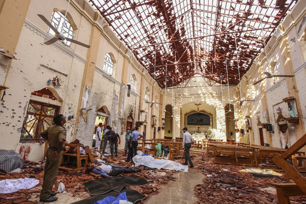 Dead bodies of victims lie inside St. Sebastian's Church damaged in blast in Negombo, north of Colombo, Sri Lanka, Sunday, April 21, 2019.  More than ...