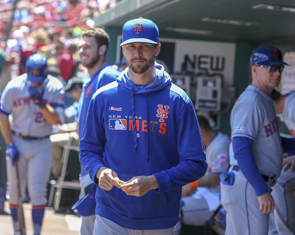 New York Mets' Jacob deGrom stands in the dugout prior to a baseball game against the St. Louis Cardinals, Saturday, April 20, 2019, in St. Louis. (AP...