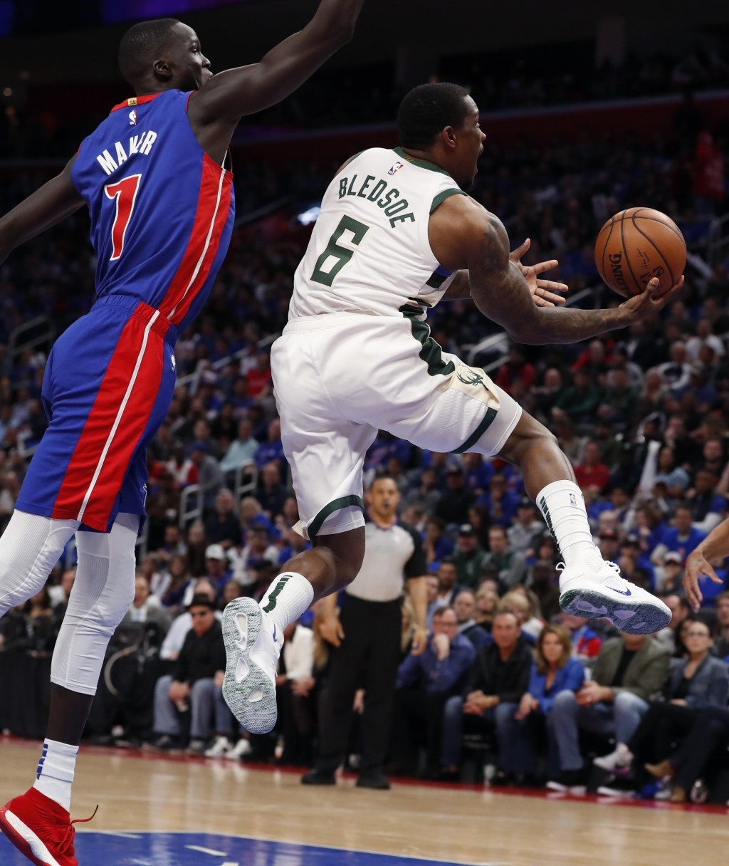 Milwaukee Bucks guard Eric Bledsoe (6) makes a layup as Detroit Pistons forward Thon Maker (7) defends during the first half of Game 3 of a first-roun...