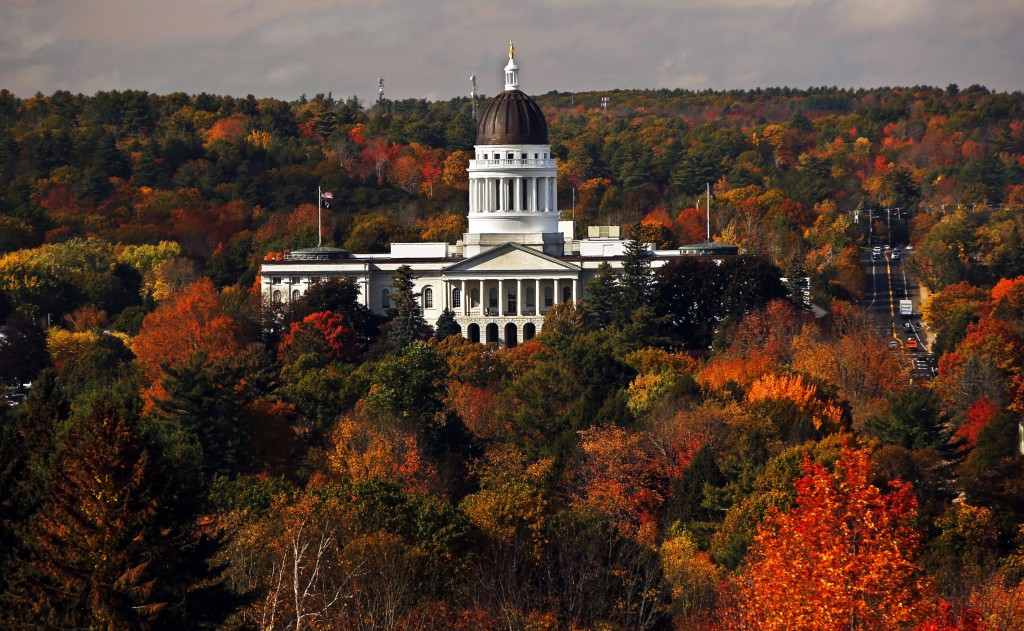 FILE - In this Oct. 23, 2017, file photo, the State House is surrounded by fall foliage in Augusta, Maine. At least 14 Democrats and eight Republican ...