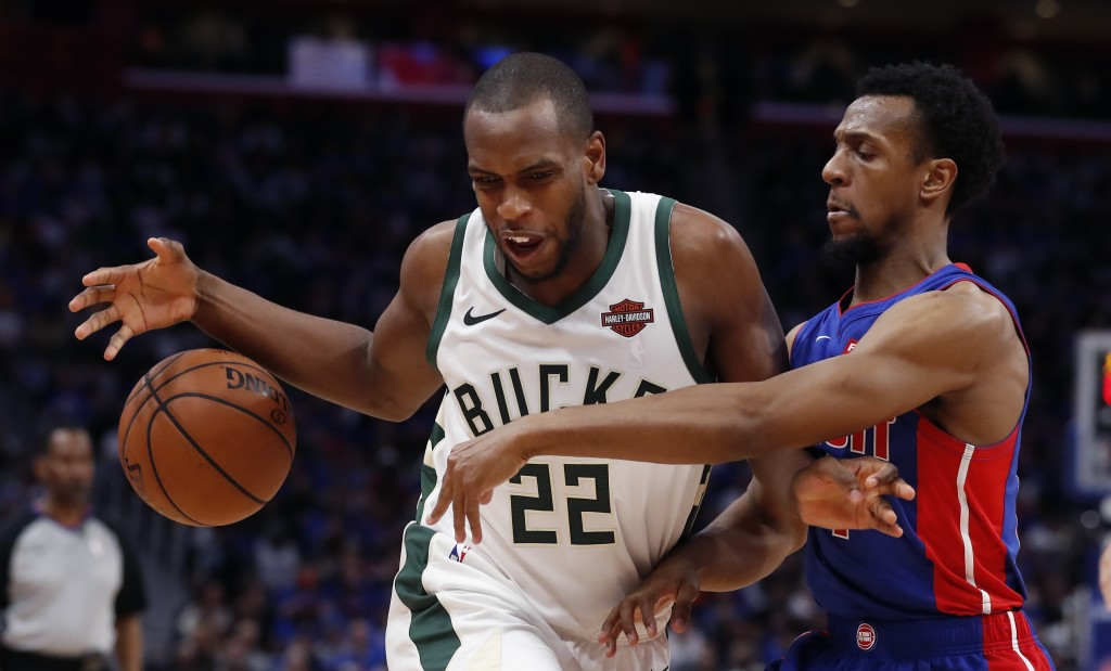 Detroit Pistons guard Ish Smith knocks the ball away from Milwaukee Bucks forward Khris Middleton (22) during the first half of Game 3 of a first-roun...