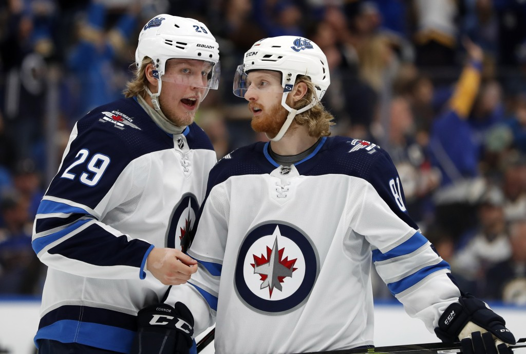 Winnipeg Jets' Patrik Laine (29), of Finland, and Kyle Connor (81) talk during the third period in Game 6 of an NHL first-round hockey playoff series ...