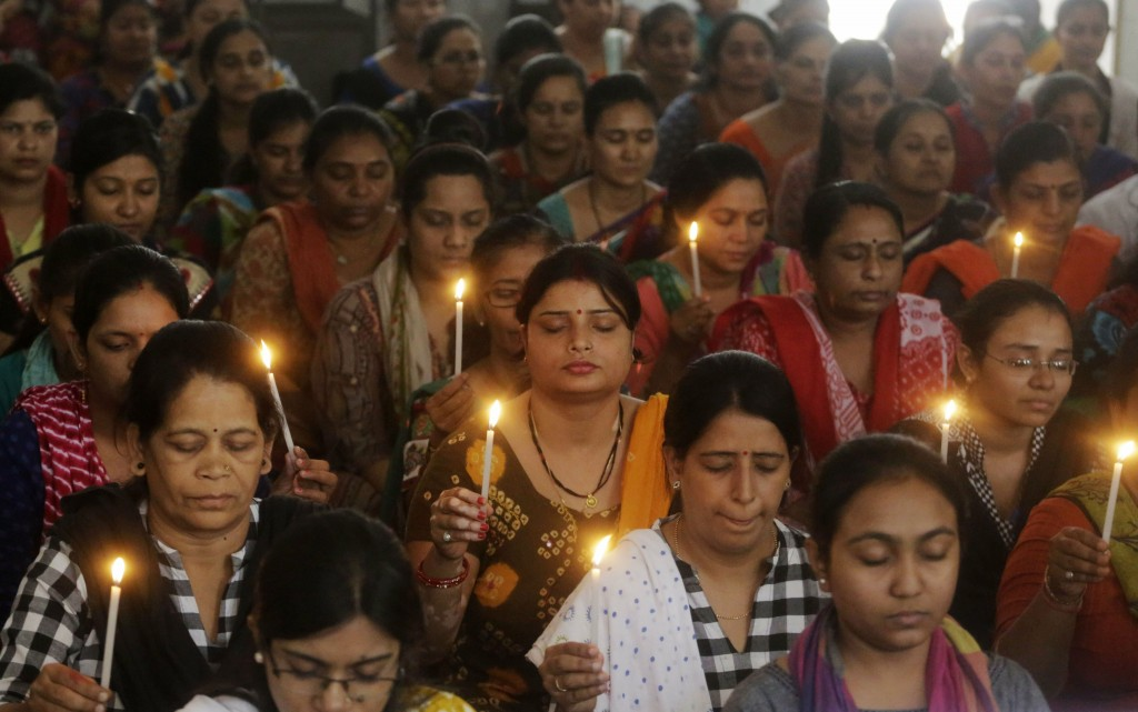 Indian staff at a school pray for the victims of Sunday's blasts in Sri Lanka, in Ahmadabad, India, Monday, April 22, 2019. Easter Sunday bombings tha...