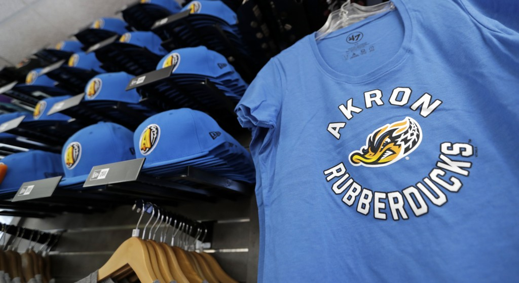Akron RubberDucks logos show up on hat and shirt merchandise in the team shop before a minor league baseball game between Akron and Bowie, Thursday, A...