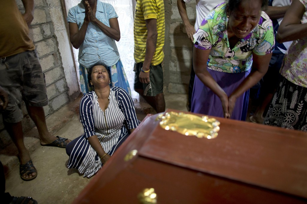 Relatives cry near the coffin with the remains of 12-year Sneha Savindi, who was a victim of Easter Sunday bombing at St. Sebastian Church, after it r...