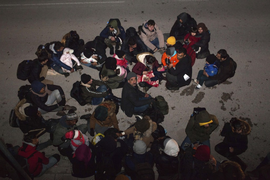 Migrants from Syria and Iraq wanting to register for asylum, sit on the road in Orestiada town, northeastern Greece, Monday, April 22, 2019. Greek aut...