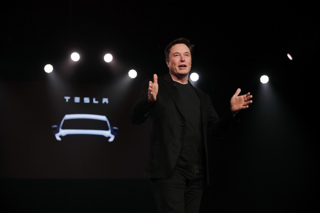 FILE- In this March 14, 2019, file photo Tesla CEO Elon Musk speaks before unveiling the Model Y at Tesla's design studio in Hawthorne, Calif. Musk ap...