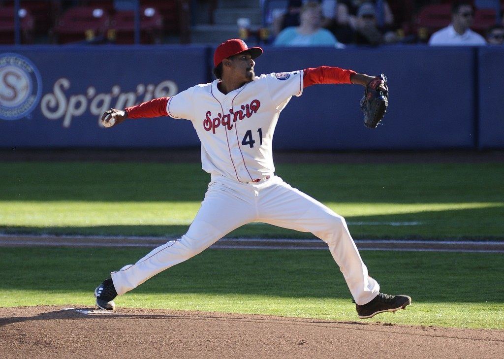 """In this June 26, 2018 provided by the Spokane Indians, pitcher Werner Leal throws in a game in Spokane, Wash. The """"Sp'q'n'i"""" logo on the jersey front ..."""