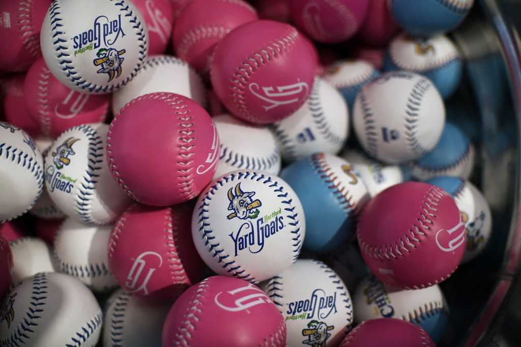 Hartford Yard Goats souvenir baseballs are displayed for sale in a gift shop inside Dunkin' Donuts Park before a game between the Yard Goats and the R...