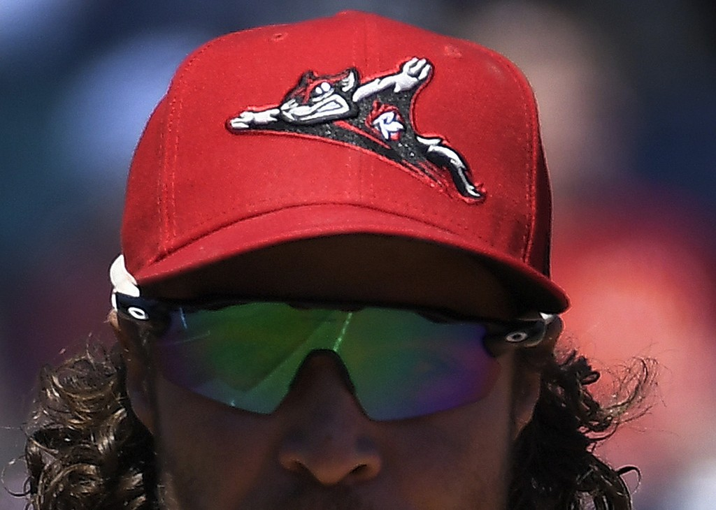 A flying squirrel logo soars on the cap of a Richmond Flying Squirrels player during a game against the Hartford Yard Goats at Dunkin' Donuts Parkin H...