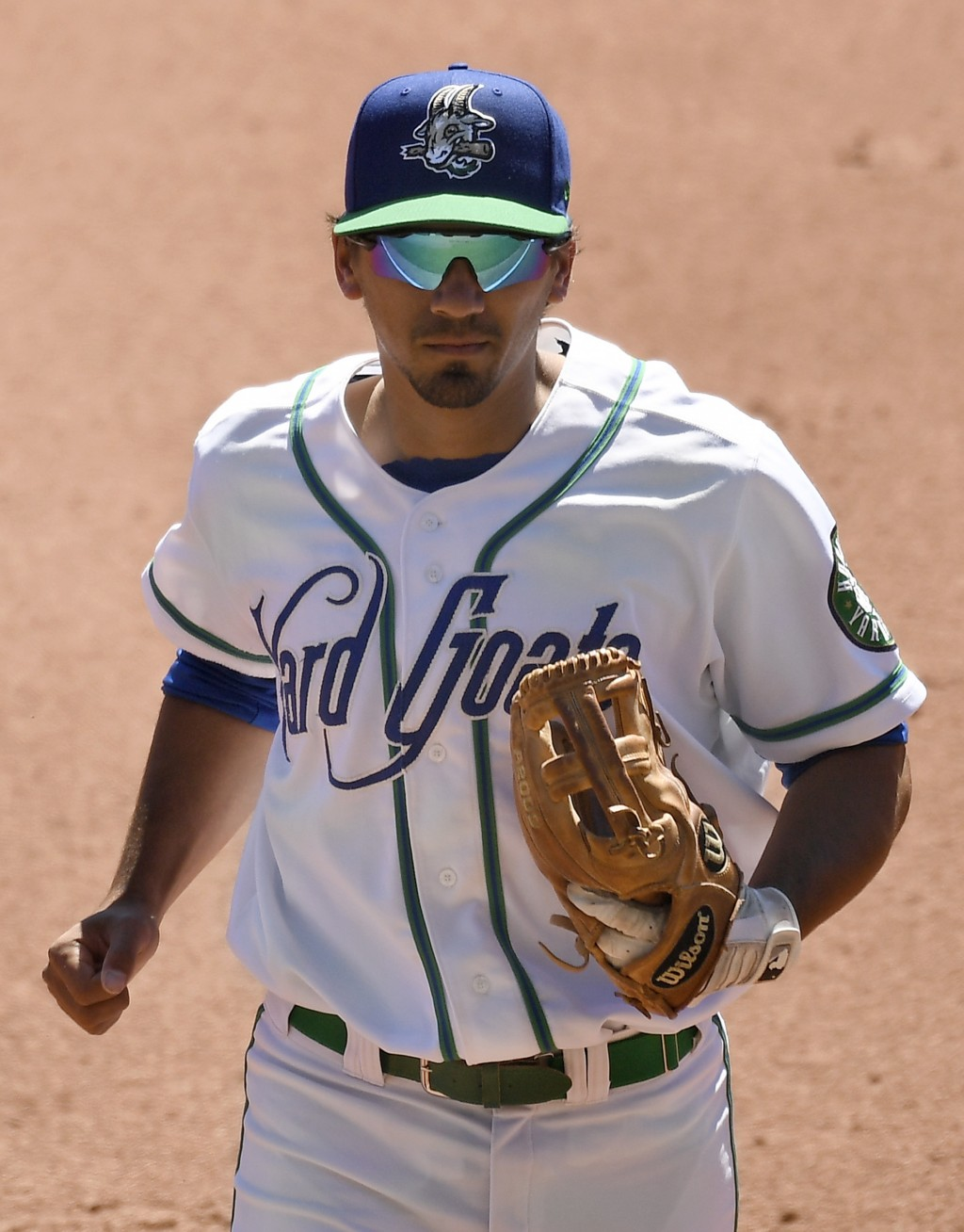 Hartford Yard Goats shortstop Scott Burcham runs off the field between innings during a game against the Richmond Flying Squirrels at Dunkin' Donuts P...