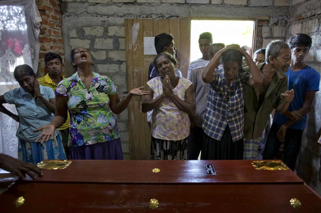 Relatives weep near the coffin with the remains of 12-year Sneha Savindi, who was a victim of Easter Sunday bombing at St. Sebastian Church, Monday, A...