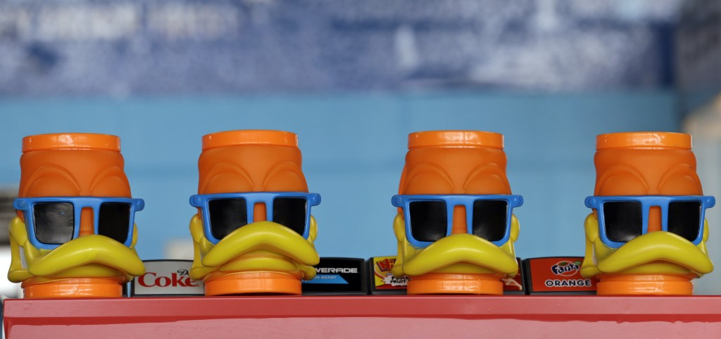 Duck mugs rest on a shelf before a minor league baseball game between the Akron RubberDucks and the Bowie Baysox, Thursday, April 18, 2019, in Akron, ...