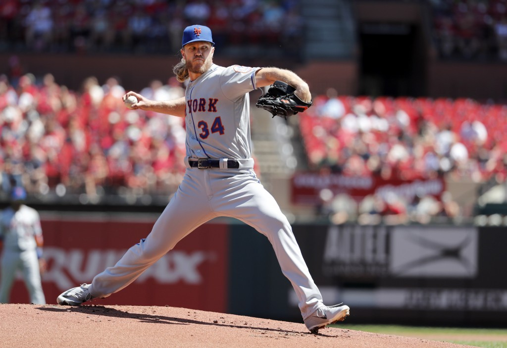 New York Mets starting pitcher Noah Syndergaard throws during the first inning of a baseball game against the St. Louis Cardinals Sunday, April 21, 20