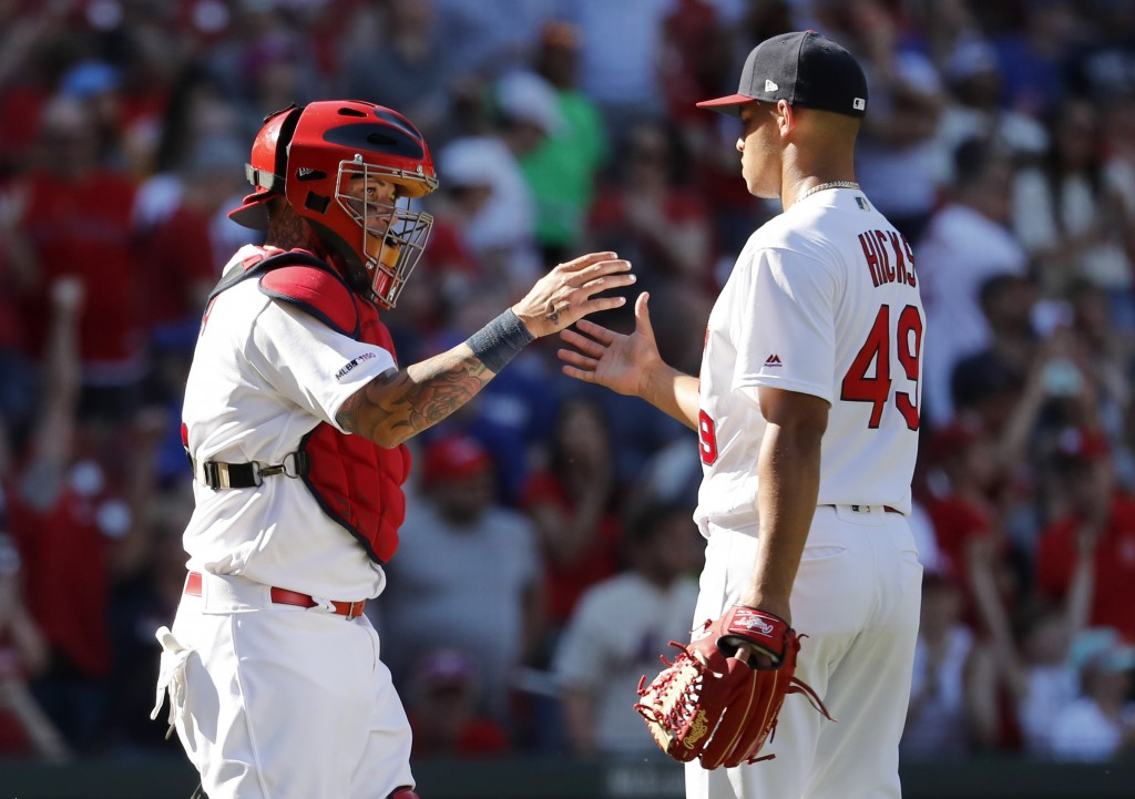 St. Louis Cardinals catcher Yadier Molina, left and relief pitcher Jordan Hicks celebrate following a 6-4 victory over the New York Mets in a baseball