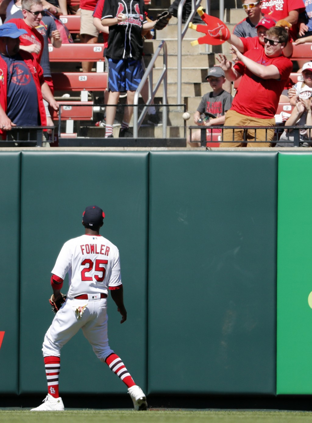 St. Louis Cardinals center fielder Dexter Fowler watches his solo home run by New York Mets' Robinson Cano during the fifth inning of a baseball game