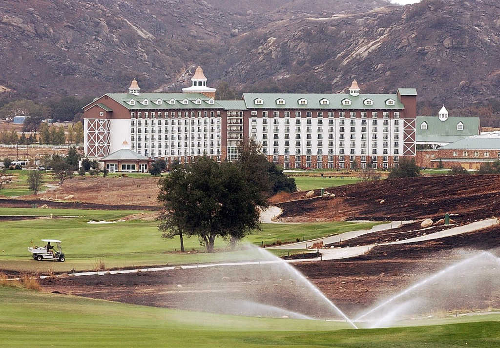 FILE - This Oct. 31, 2003, file photo shows a groundskeeper in a golf cart cuts through the golf course at the Barona Resort and Casino at the Barona ...