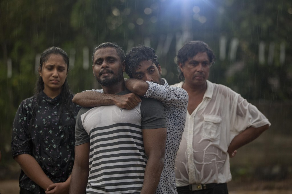 Mourners grieve at the burial of three members of the same family victims of Easter Sunday bomb blast at St. Sebastian Church in Negombo, Sri Lanka, M...